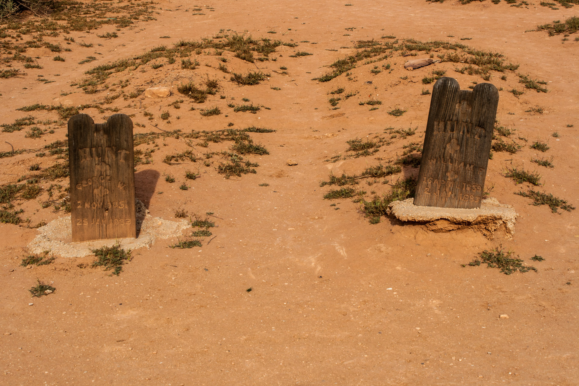 A Desert Ghost Town Cemetery (two old stones)
