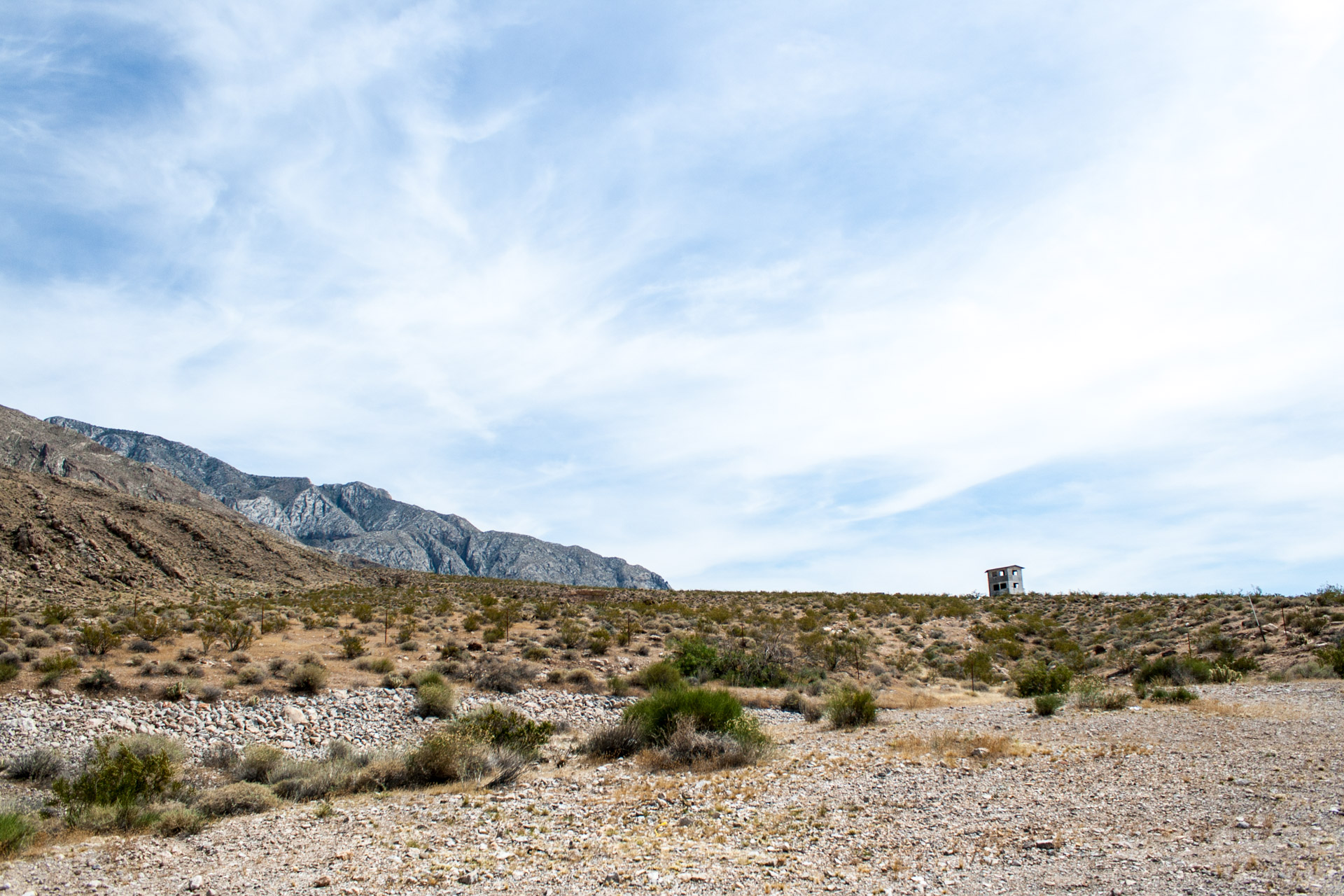 A Lonely Desert Mountain House (back far right)