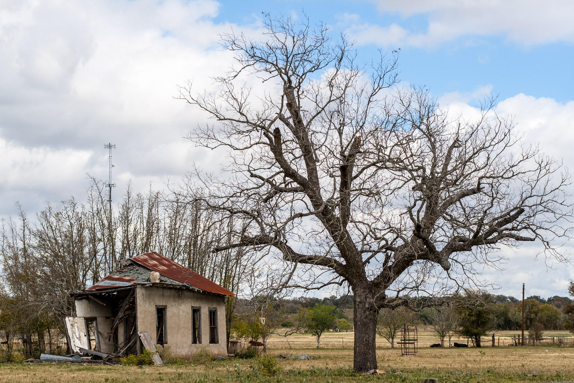 La Grange, Texas - An Impacted Roof Farmhouse (left far)