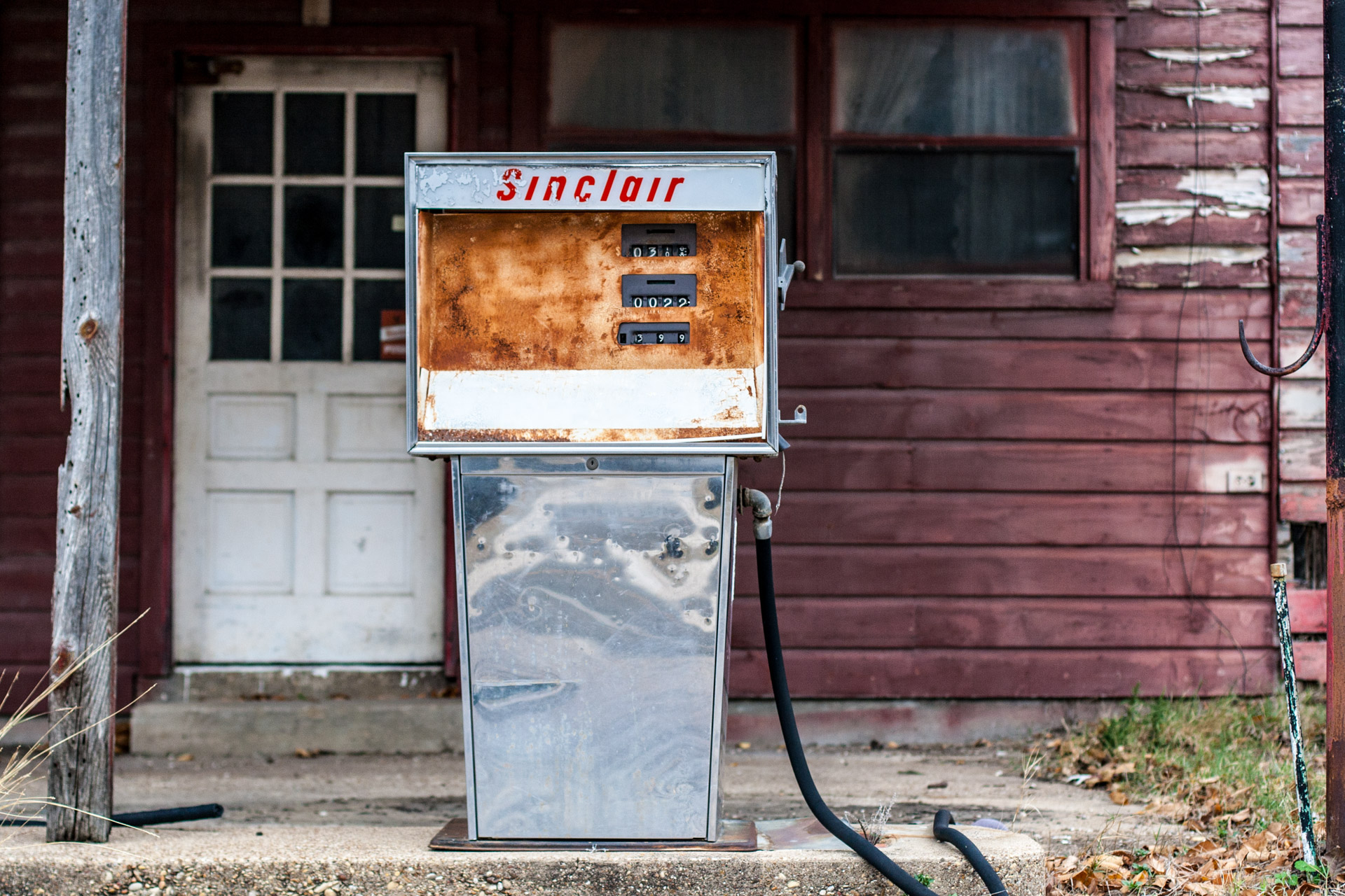 Kosse, Texas - Old Gas Pumps Gas Station (rust pump far)