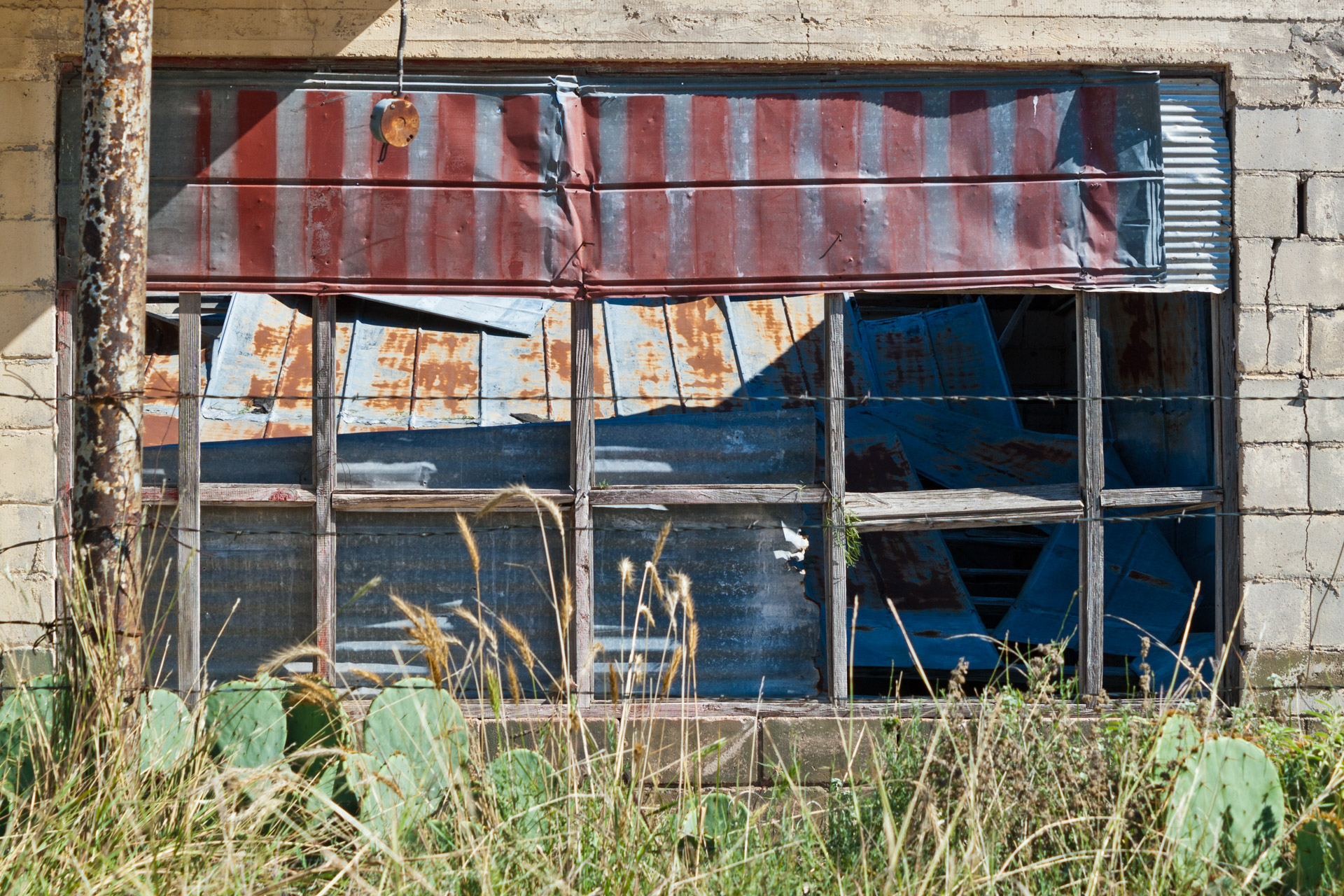 Talpa, Texas - The Falling Tin Store (window)